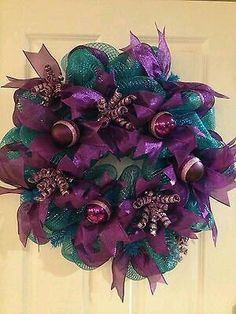 Turquoise And Purple Deco Mesh Wreath minus the Xmas balls Wreaths And Garlands, Deco Mesh Wreaths, Holiday Wreaths, Holiday Crafts, Christmas Decorations, Ribbon Wreaths, Winter Wreaths, Table Decorations, Peacock Christmas