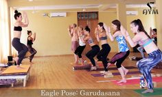 https://flic.kr/p/JMfGeZ | Eagle Pose Garudasana | #Eagle #Pose: #Garudasana in #yoga 1. Stand up straight.  2. Bend your knees slightly, lift your left foot and cross your left thigh over the right.  3. Hook the top of the left foot behind the right calf.  4. Stretch your arms to the sides parallel to the floor.  5. Bend your elbows and raise your forearms perpendicular to the floor.  6. Put your right elbow over your left elbow and press your palms together.  7. Look straight.