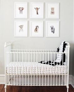 A dreamy nursery filled with sweet details. Modern Burlap crib sheet and blankets are complete with adorable animal print photos.