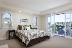 Adorable bedroom, complete with french doors and view, in Rockridge home.