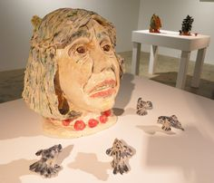 Sally Saul's arresting ceramic self-portrait portrays her as if in mid-sentence, her eyes looking into the distance as if trying to phrase something just so. Surrounded by tiny attentive birds, what she says has caused nature to stop and listen. (At LaunchF18 on the Lower East Side through March 6th). Sally Saul, Self-Portrait, clay and glaze, 12 x 9 x 8 inches, unique, 2010.