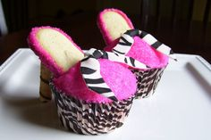 Hot pink and zebra themed party for a young girl. High heel cupcakes were the request and I love how they turned out! zebra themed cupcakes