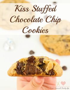 Kiss Stuffed Chocolate Chip Cookies are a delicious cookie dessert for any chocolate lover. Each chocolate chip cookie has a chocolate Hershey's Kiss stuffed inside. - Kiss Stuffed Chocolate Chip Cookies Recipe on Sugar, Spice and Family Life
