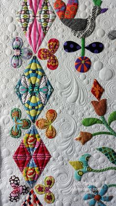 https://flic.kr/p/Vd9Nex   B7   Harriot by Sue Cody for Material Obsession. Applique work by Beth and quilted by Judi Madsen