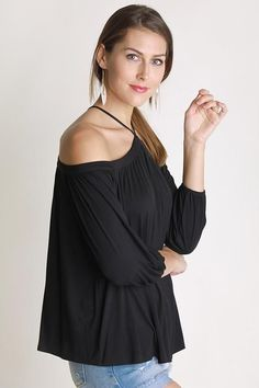 The Sing It Now Spaghetti Strap Off The Shoulder Top - Black is the perfect top to put on your favorite song and lose yourself in the music! This soft top is a stunning black that falls from spaghetti straps to an off the shoulder neckline, 3/4 sleeves and relaxed bodice. This top is made with Bamboo fabric so it is very soft!   Black off the shoulder top - black off the shoulder night top - long sleeve black off the shoulder top - dressy off the shoulder top