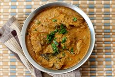 Chicken salna, a Tamil Nadu style curry served with Parotta. Fragrant chicken curry prepared with spices like cumin, fennel seeds, pepper corns and coconut.
