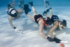 Underwater hockey, aka 'Octopush', is a rudimentary form of hockey played on the floor of a pool. Hockey, Scuba Diving, Love Of My Life, Underwater, Swimming, Floor, Usa, Videos, Sports