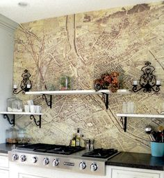 what a cool idea...a map of Paris over the stove. Put up with wallpaper paste and then polyed over.  Hmmm......