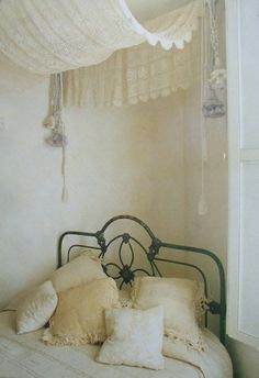 table cloth used for bed canopy; very shabby chic - I might have to do this.