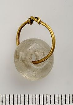 Clear glass bead hanging on a gold wire - Birka Grave 523