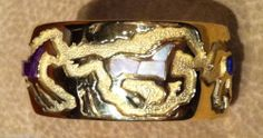 """Ben Nighthorse Campbell is the artist of this nice,heavy gauge 18 kt gold multi-inlay, multi-horse bracelet.  Inlay stones are lapis, opal, sugilite and angel skin coral. This bracelet is a small size, measuring 6 1/2"""" all the way around measuring the inside of the bracelet.  The width of this bracelet is 1 1/16"""". a Native American Indian born into a  Northern Cheyenne family."""