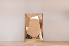 Alto, a large, polished brass, mirror-like sculpture by the Chile based design studio, The Andes House.