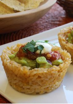 Mexican Rice Cups – Mexican-inspired meals will never be the same after you try these Mexican Rice Cups! Fill each cup with guacamole and top with a sprig of fresh cilantro. Find more delicious and easy recipes at www.pinterest.com/SuccessRice
