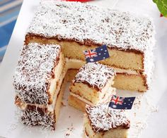 The humble lamington is one of Australia's most well-loved desserts. This version creates a jumbo version of the tasty chocolate and coconut sponge, and stuffs it with fresh whipped cream and raspberry jam to produce a wonderfully sweet cake. Aussie Pie, Aussie Food, Australian Desserts, Australian Recipes, Barbecued Lamb, Lamb Kebabs, Square Cake Pans, Australia Day, Aussies