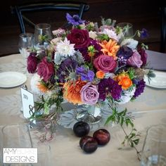 A shot of one of our garden inspired centerpiece with contrasting purples and oranges that creates such an easy going elegant wedding look. Keeping it all together was the fabulous ladies from @everyelegantdetail . Plums, garden roses, dahlias, jasmine vines, anemones, and ranunculus Location @tfwweddings @everyelegantdet #purple