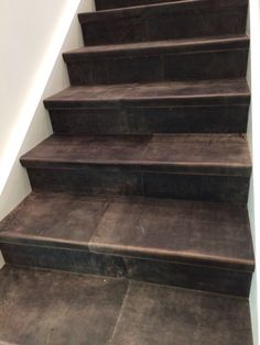 Chocolat staircase in Leather . All steps are fully wrapped in Leather