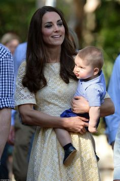 Prince George gives a nearby spectator a rather menacing look while safe in the arms of his mother on his visit to Taronga Zoo