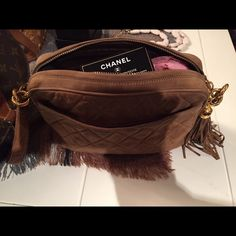 Vintage Chanel Gorgeous vintage suede chanel cross body, tassel waiting .authentic. Has card with it .serial tag inside CHANEL Bags Crossbody Bags