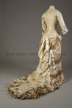 """Wedding Ensemble, American, 1879  Label: """"M. Dake/123 So. Jefferson St/Dayton O""""  Silk damask, silk faille, satin ribbon, fringe  This wedding dress was worn by the donor's grandmother, Harriet Snyder King, on May 13, 1879  Gift of Mrs. Robert V. Carr in memory of the King Family of Suffield, CT, KSUM 1996.30.1 ab"""