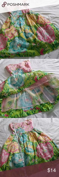 Lilly Pulitzer Pink Flower Garden Dress Lilly Pulitzer pink strapless dress, size 2. This dress is authentic, unfortunately it needs mending  (Selling as-is, see tear in fabric by zipper) letting this go for a steal because I'll never bother to fix it. See photos for details. Lilly Pulitzer Dresses Strapless