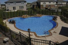 Vinyl pools aren't just square anymore! This is a custom vinyl Mickey Mouse shaped pool done by All Seasons Pools and Spas from Orland Park, IL