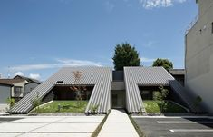 TSC architects clads wedge-shaped dental clinic in japan in tiles