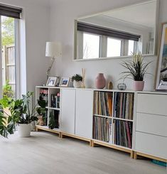 EKET white, Wall-mounted shelving unit w 4 comp. This clever EKET cabinet is always ready to lend a hand, whether it's for storing, organising or emptying your pockets. Eket, Flat Interior, House Rooms, Living Room Decor Inspiration, Home, Interior, Living Spaces, Low Bookshelves, Room