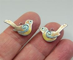 This weeks birds are a pair of tiny little songbirds which will be a pair of earrings. They are made using Art Clay Silver and have gol. Metal Clay Jewelry, Bird Jewelry, Enamel Jewelry, Copper Jewelry, Jewelry Crafts, Jewelry Art, Jewelery, Jewelry Design, Earrings Handmade