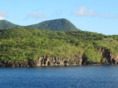 The cliffs of Morne Champagne at Les Anses d'Arlet on Martinique, Eastern Caribbean, are of volcanic origin. Caribbean, Champagne, River, The Originals, Outdoor, Outdoors, Rivers, The Great Outdoors
