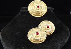 Today's favourite by @allthatvintage - 50s/60s Sphinx Signed #Brooch & #Earrings, £22. Vintage Signed Sphinx Demi Parure made up of a Brooch and Clip Earrings. Both the brooch and earrings are goldtone with a raised design and the centre is set with a red glass stone and faux pearls on both the brooch and earrings. The Brooch measures 1 1/2 inches and has a secure roll over clasp and signed Sphinx. The Clip Earrings measure 1 1/4 inches are clip and are also signed Sphinx...