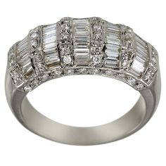 Diamond Wedding Band Baguette Diamonds Wedding Band Baguette Rings 14K Gold -  This wide diamond band is adorned with a combined total weight of 1.30cts of brilliant white round and baguette diamonds. This is a domed, 18K white gold, wide diamond band. It has vertical rows of bright sparkling round diamonds, set in between horozontal rows of channel set baguette diamonds. This is a superbly crafted Dacarli design, which is certain to please the wearer for many years to come.  The settings…