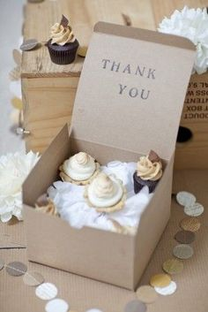 Mini cupcakes in a kraft box for guests to bring home after the reception