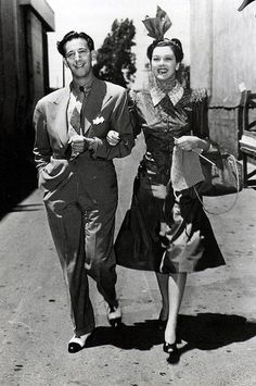 """Adrian and Rosalind Russell take a stroll. Rosalind Russell is wearing Adrian's perfect design for her character in the film """"The Women"""", 1939 Hollywood Costume, Hollywood Fashion, Hollywood Glamour, Hollywood Stars, Hollywood Actresses, Hollywood Men, 1940s Fashion, Hooray For Hollywood, Golden Age Of Hollywood"""