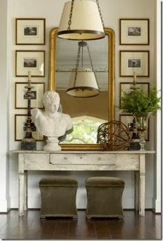 entrance console with art, mirror, ottomans Roses and Rust: Making an Entrance