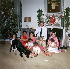 President Kennedy and his family celebrating Christmas. Of course Charlie is right in the middle! : )