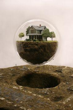Miniature floating bubble world by Thomas Doyle