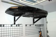 The traditional roof box, like a Thule, is not the easiest item to store in a garage. There is really no storage system designed for that purpose by the manufacturers of these boxes. Roof Storage, Bike Storage, Storage Boxes, Storage Ideas, Storage Baskets, Garage Organization Tips, Garage Storage Systems, Garage Roof, Garage House