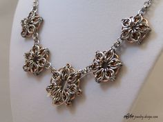 """5, 6, and 7 pointed """"Celtic Stars"""" necklace, in round and square wire stainless steel and copper."""