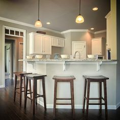 An #EatingArea at the #KitchenBar with wooden #Stools in Reilly model, our Parade of Homes entry at 39 Summerlyn Drive, #Ephrata in #SummerlynGreen