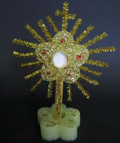 Craft for Catholic Kids – Make a Monstrance! pool noodle, craft stick, pipe cleaners, glitter