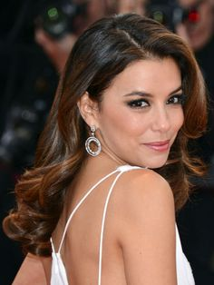 Eva Longoria's vintage-style curls are just as polished for a fancy affair as an intricate updo. #wedding #hair