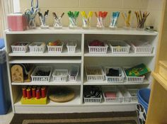 Great Reggio inspired art center. I would love to do something similar to this, but using natural materials instead of plastic.