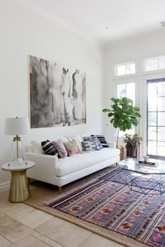 White linen sofa and marble side table: http://www.stylemepretty.com/living/2016/09/16/see-how-a-party-stylist-translates-her-cool-girl-style-into-her-home-x2/ Photography: Amy Bartlam - http://www.amybartlam.com/