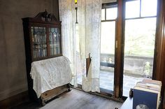 Some curtains, like these in the upstairs hall of Elmwood, are literally falling apart from age. Photo by Tom Eble