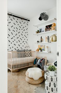 Phoenix's room is just a delight; they made use of every inch. The SNIGLAR Crib and the ALSEDA Stool are from Ikea, and the floor lamp is from Target.