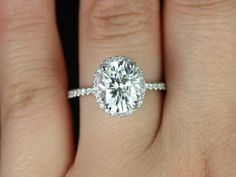 Federella Original Size 14kt White Gold Thin Oval FB Moissanite Halo Engagement Ring (Other metals and stone options available). $2,350.00, via Etsy.