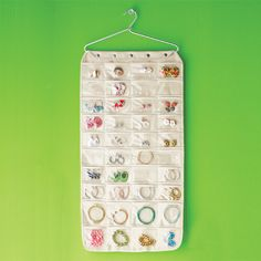 Canvas Pocket Hanging Jewelry Organizer from The Container Store: at first I was a little off-put by hanging my jewelry in plastic pockets, but it sure makes it easy to find things! Plus it is kind of fun to walk into my closet and see all my sparklers.