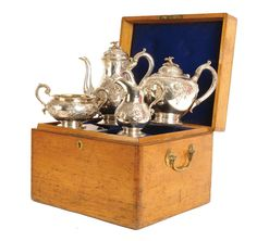 An impressive Victorian silver four piece tea and coffee service in original fitted oak box, the matching set with repoussé embossed florals and fancy trellis decorated panels in the French manner, applied floral and leaf finials to the tea and coffee pots, acanthus leaf thumb pieces to the handles, the sugar bowl and cream jug internally washed with gilt. Matching hallmarks to all for London 1859 by John Samuel Hunt, each further embossed 'Hunt & Roskell, Late Storr & Mortime