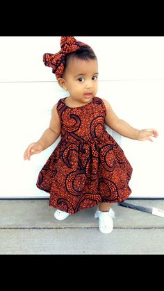 a very beautiful baby girl dress made from authentic African fabric from east Africa and it comes in different sizes per order