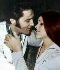 The original of this is actually Priscilla and Lisa Marie touching each other's faces!  .3 picture are been used to take a photo shop of Elvis and Lisa !!!!
